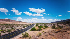 Time Lapse - Beautiful Clouds Moving Over the Road Stock Footage