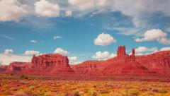Time Lapse - Beautiful Clouds Moving Over Monument Valley - stock footage