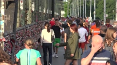 4K Crowded Hohenzollern bridge pedestrian people cross Koln landmark busy alley  Stock Footage