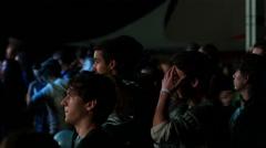Teen fan spectators in lumiere enjoying a music concert performance Stock Footage