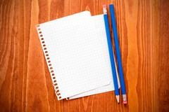 Stock Photo of Blank paper  with a pencils