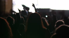 Crowd of fan spectator silhouettes on concert lumiere cheerfully swaying hands Stock Footage