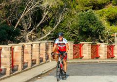 Tossa de Mar. Athlete bicyclist. Stock Photos