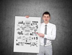 Man holding poster with business scheme Stock Photos
