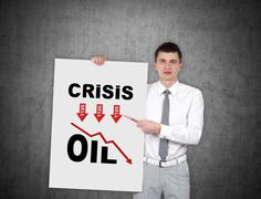 man holding poster with srisis chart - stock photo