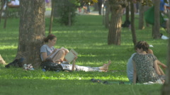 WRelaxing and reading in Central Park, Cluj-Napoca Stock Footage