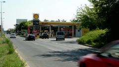 Gas station Shell near by the city - car brakes and refuel - around pass cars Stock Footage