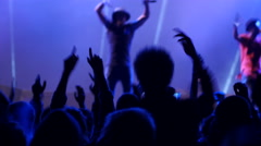 Dancing fan spectator silhouettes on concert lumiere cheerfully swaying hands up Stock Footage