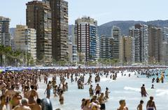 Stock Photo of Typical views of the beach in Benidorm holiday season.