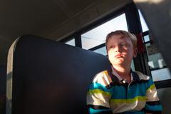 Lonely Kid on the School Bus - stock photo