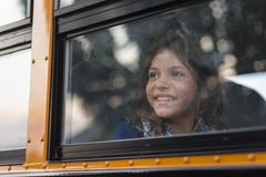 Optimistic Kid on the School Bus - stock photo
