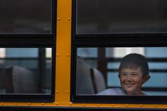 Stock Photo of Children on the School Bus - happy asian kid