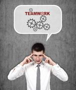 man thinking about teamwork - stock photo