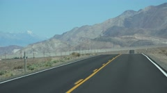 HIGHWAY, driving by desert mountains, passing motorhome - stock footage