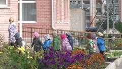 Mentor is leading a group of children. Stock Footage