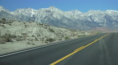 HIGHWAY, driving by desert mountains, yellow line road Stock Footage