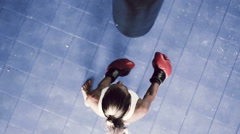 Athletic Woman Boxing Fitness Training in Gym. Punching Body Bag Shot From Ab Stock Footage