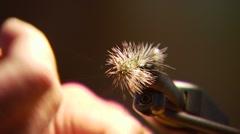 Flyfisher adjusting bait Stock Footage