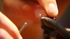 Flyfisher tying string in fishing rod Stock Footage