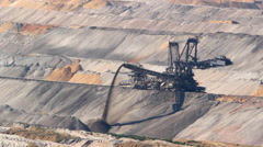 Large excavator operating in open pit coal mine Stock Footage