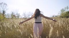 Cute girl flees field slow motion Stock Footage