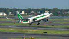 Alitalia Airlines plane lifts off runway Stock Footage