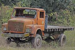 old truck at junk yard - stock photo