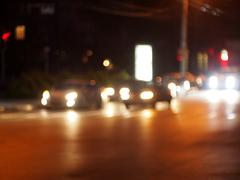Defocused cars, the lights from the headlights - stock photo