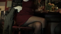 Leggy woman sitting at the bar Stock Footage