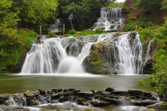 Nice waterfall in autumn forest Stock Photos