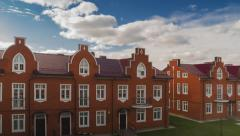 Beautiful clouds over red brick town houses Stock Footage