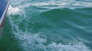 Stock Video Footage of Boat on water causing waves and ripples. Slow motion footage.