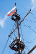 Russian flag flutters on a mast sailing vessel on a background of blue sky - stock photo