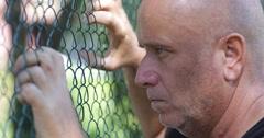 Sad Man Seek Help Need Freedom Immigrant Refugee Homeless Border Line Iron Fence Stock Footage