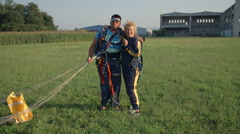 Senior lady and her instructor for sky diving - stock footage