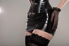 Close-up shot of fetish girl wearing latex corset and skirt Stock Photos