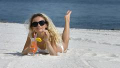 Girl drink cocktail on a beach Stock Footage