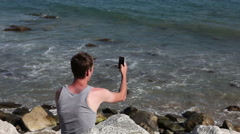 Caucasian man making pictures on his mobile phone Stock Footage