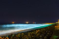 5k Night time lapse, stars over ocean and glowing beach waves Stock Footage