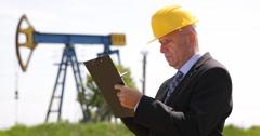 Engineer man Prospect Documentation Plans Oil Pump Rig Platform Gas Installation Stock Footage