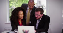 Business advisers analyzing financial figures during a company meeting. Stock Footage