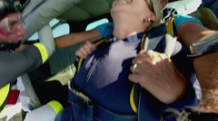 Older lady sky dives for the first time - stock footage