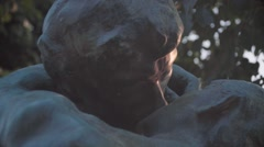 Statues kissing, Paris Stock Footage