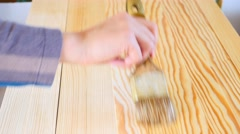 Footage of a person applying a wood protection liquid to some planks Stock Footage