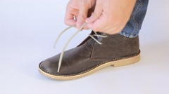 Men's shoes on a white background, to tie shoelaces Stock Footage