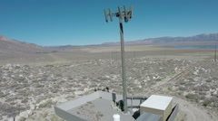 Cell phone site tower cellular telephone antennae communications equipment Stock Footage