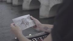 Paris romantic, Man looking at postcard - stock footage