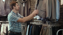 The guy tries on a jacket Stock Footage