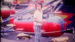 2572 - children enjoy rides at local amusement park - vintage film home movie Stock Footage