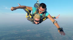 Couple is sky diving in the air - stock footage
